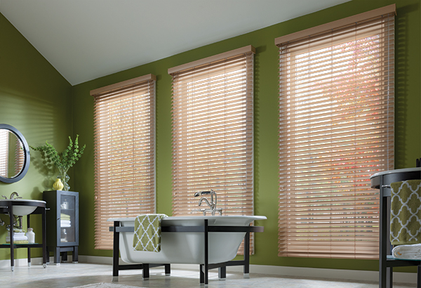 light brown faux wood blinds in green room