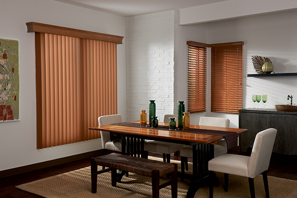 short brown vertical blinds on white walls