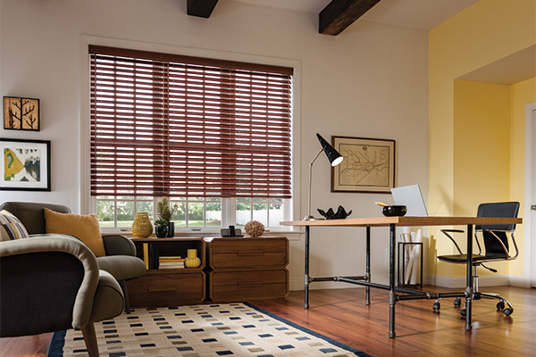 Brown faux wood blinds on white wall