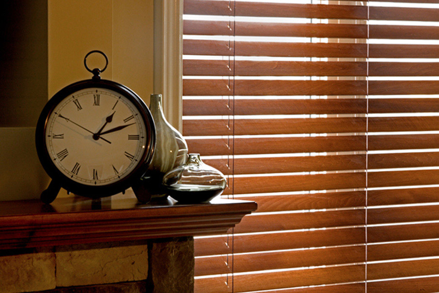 brown wooden blinds beside a table clock