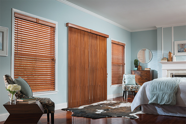 brown wooden vertical and horizontal blinds on a light blue wall